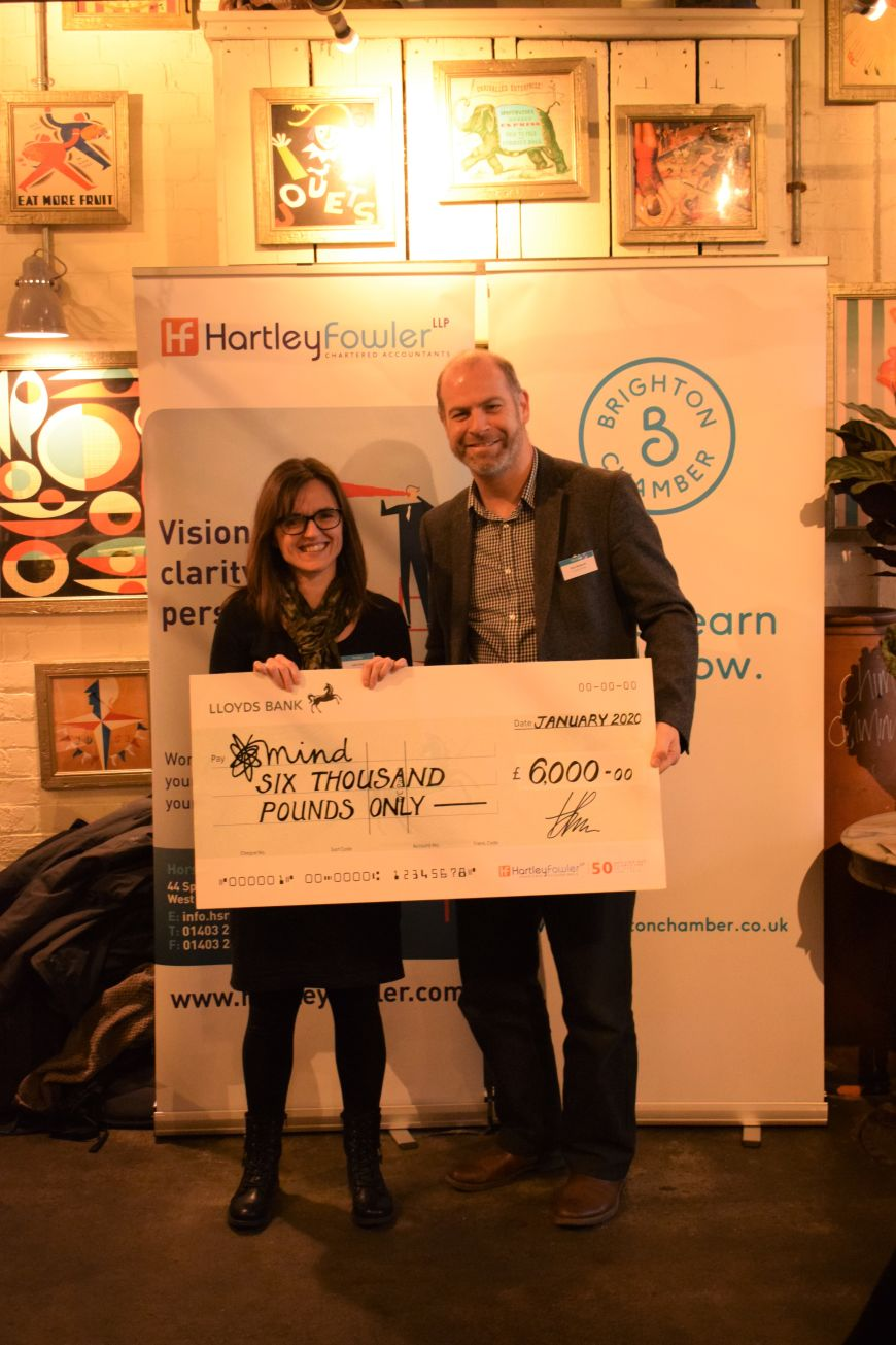 Hartley Fowler presenting Mind with a cheque as their chosen charity of 2019.